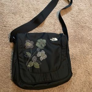 The North Face crossbody bag w/ stitched flowers